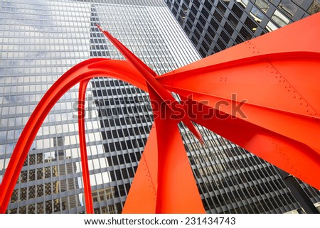 CHICAGO, IL - JAN 5: Flamingo sculpture on January 5, 2013, created by artist Alexander Calder in 1973, located in the Federal Plaza in Chicago, Illinois, US. - stock photo