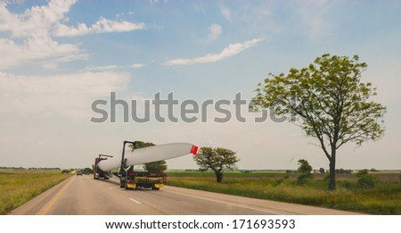 CHICAGO, IL - June 12: Oversize load of Wind Generator turbine wing on a specialized semi truck  on June 12, 2013. - stock photo