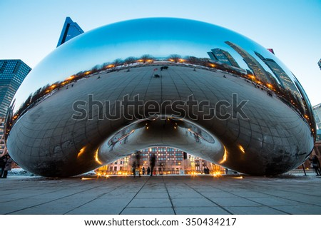 CHICAGO, IL - March 6, 2015: Cloud Gate and Chicago skyline in Millennium Park, Chicago, Illinois, USA - stock photo