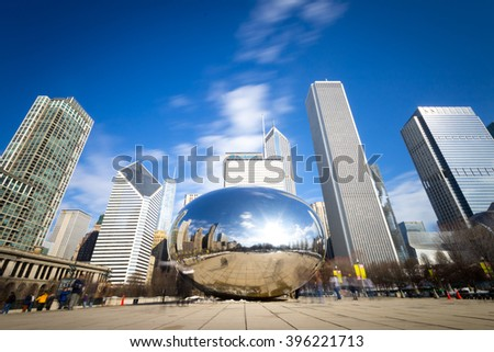 CHICAGO, IL - March 7, 2015: Cloud Gate and Chicago skyline in Millennium Park, Chicago, Illinois, USA - stock photo