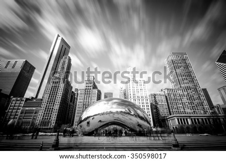 CHICAGO, IL - March 7, 2015: Cloud Gate and Chicago skyline in Millennium Park in B&W, Chicago, Illinois, USA - stock photo
