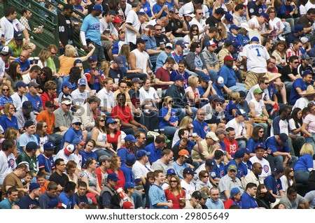 CHICAGO, IL - May 5: Fans cheering during the Chicago Cubs vs. San Francisco Giants game at Wrigley Field May 5, 2009 in Chicago, IL. - stock photo