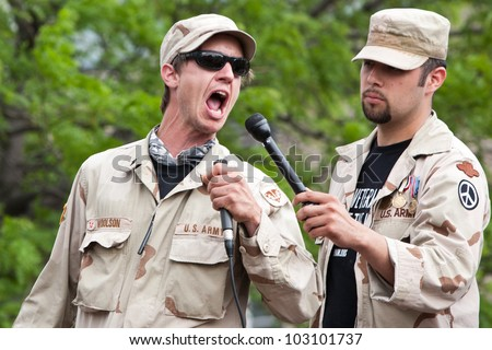 CHICAGO, IL- MAY 20: Iraq War Veterans speak during a protest of the 25th NATO Summit. The first summit held outside of Washington, D.C. in the United States, Chicago, Illinois, May 20-21, 2012. - stock photo