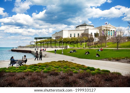 CHICAGO, IL - May 4, 2014: People visit the Shedd Aquarium campus looking out over Lake Michigan at Northerly Island on one of the first warm days of spring, May 4, 2014, Chicago, Illinois. - stock photo