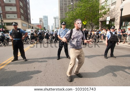 CHICAGO, IL- MAY 20: Police stand guard while protesters gather at the 25th NATO Summit. The first summit to be held outside of Washington, D.C. in the United States, Chicago, IL, May 20-21, 2012. - stock photo