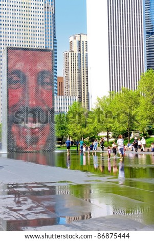 CHICAGO,IL - MAY 15: The Jaume Plensa's Crown fountain on May 15, 2009 in Millennium Park, Chicago, Illinois. An interactive work of public art and video sculpture featured. Designed by Jaume Plensa. - stock photo