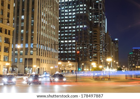 CHICAGO, IL - OCT 4: Chicago downtown at night on October 4, 2011 in Chicago, Illinois. Chicago is the third most populous city in the United States, after New York City and Los Angeles - stock photo