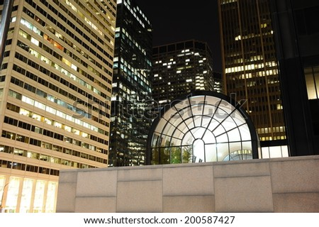 CHICAGO, IL - OCT 6: Chicago downtown near Willis Tower at night on October 6, 2011 in Chicago. Chicago is the third most populous city in the United States, after New York City and Los Angeles - stock photo