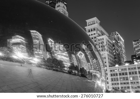 CHICAGO, IL - OCT 4: Cloud Gate and Chicago skyline on October 4, 2011 in Chicago, Illinois. Cloud Gate is the artwork of Anish Kapoor as the famous landmark of Chicago in Millennium Park - stock photo