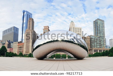 CHICAGO, IL - OCT 6: Cloud Gate and Chicago skyline on October 6, 2011 in Chicago, Illinois. Cloud Gate is the artwork of Anish Kapoor as the famous landmark of Chicago in Millennium Park. - stock photo