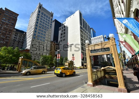 CHICAGO, IL - OCTOBER 10: Downtown Chicago Modern Architecture, and Lifestyle on October10, 2015 in Chicago,USA. Chicago has prominent buildings in a variety of styles by many famous architects - stock photo