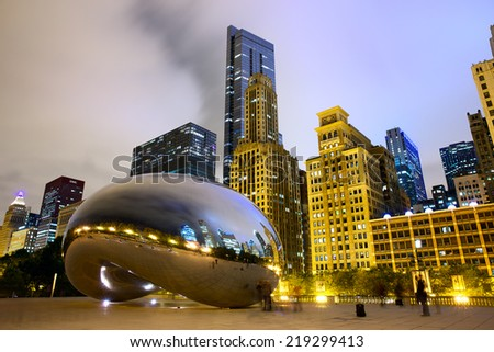 CHICAGO, IL - SEP 15: Cloud Gate sculpture and downtown skyline buildings on September 15, 2014  in Chicago, Illinois. The famous landmark of Chicago in Millennium Park at night. - stock photo