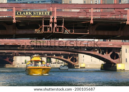 CHICAGO, IL, US - MAY 27, 2006: Chicago Water Taxi sailing in Chicago loop. The riverbuses have served 14 million passengers since 1935, and currently tour from Michigan Avenue to Chinatown. - stock photo