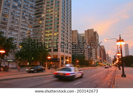 CHICAGO, IL, US - OCTOBER 15, 2007: Motion vehicles driving on Michigan street from south side to Chicago loop or downtown. - stock photo