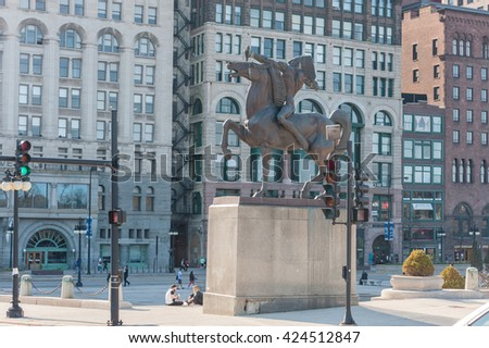 CHICAGO, ILLINOIS - APRIL 17, 2016: Chicago Park Statue with Skyscraper and Statue - stock photo