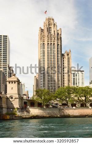 CHICAGO, ILLINOIS - AUGUST 22, 2015: Tribune Tower. Completed in 1925 in the Gothic style, the Tribune Tower is one of the most recognizable buildings in Chicago. - stock photo