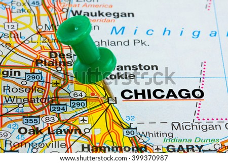 Chicago Illinois highlighted with push pin on atlas or map closeup - stock photo