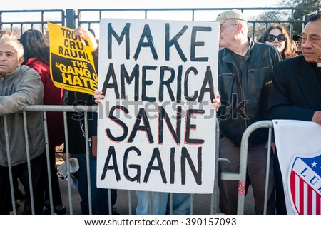 CHICAGO, ILLINOIS - MARCH 11, 2016: Anti-Trump protesters stand in opposition to Donald Trump's hate-speech outside the University of Illinois at Chicago Pavilion during the Pro-Trump Rally. - stock photo
