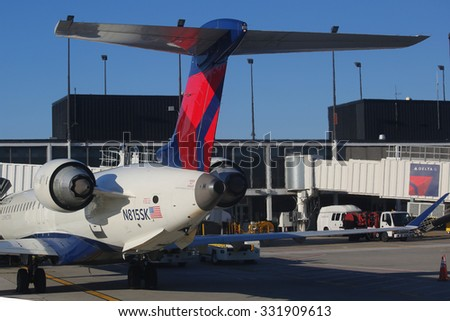CHICAGO, ILLINOIS - OCTOBER 25, 2015: Delta Airlines plane at the gate at O'Hare International Airport in Chicago - stock photo