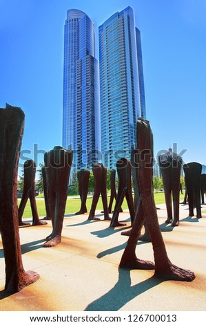 CHICAGO, ILLINOIS - SEPTEMBER 6: Agora on September 6, 2012 in Chicago, Illinois. Agora, by Magdalena Abakanowicz, is a group of 106 headless and armless iron sculptures. - stock photo