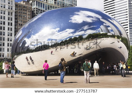 CHICAGO, ILLINOIS - SEPTEMBER 6: Cloud Gate (The Bean) on September 6, 2012 in Chicago, Illinois. Cloud Gate, a sculpture by artist Anish Kapoor, is the centerpiece of the AT&T Plaza. - stock photo