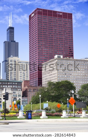 CHICAGO, ILLINOIS - SEPTEMBER 6: CNA Plaza and Willis Tower on September 6, 2012 in Chicago, Illinois. Willis Tower, also known as Sears Tower, was the tallest building in the world from 1973 to 1998. - stock photo