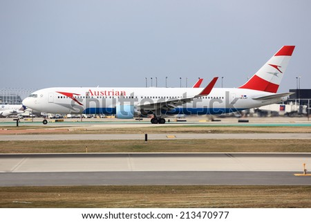 Chicago, Illinois, USA - April 12, 2014: Vienna-bound Austrian Airlines Boeing 767 on its take-off roll from Chicago O'Hare International Airport (ORD).  - stock photo