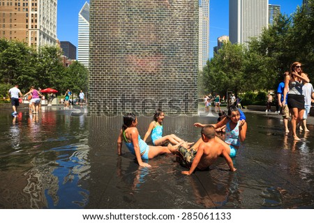 Chicago, Illinois USA - August 21, 2011: Children enjoying the popular Crown Fountain in Millennium Park on a hot summer day in Chicago. - stock photo