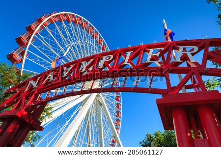 Chicago, Illinois USA - August 25, 2011: The popular Navy Pier with ferris wheel is a popular tourist destination in downtown Chicago. - stock photo