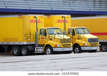 Chicago, Illinois, USA - May 3, 2014: DHL trucks and trailers parked at a cargo distribution hub at Chicago's O'Hare International Airport. Chicago - May 3, 2014 - stock photo