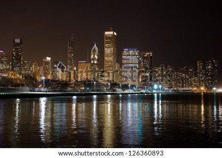 CHICAGO - JANUARY 14: Night view of the Chicago skyline on January 14, 2013 in Chicago. The Chicago skyline features three of the top five tallest buildings in the United States. - stock photo