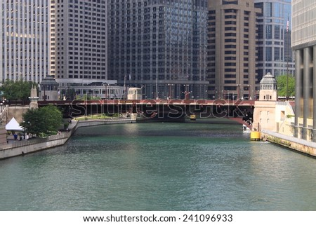 CHICAGO - JUNE 18: Bridge crossing the Chicago River on Wabash Avenue.on June 18, 2012 in Chicago, Illinois. The Windy City is the third largest city in the U.S., a worldwide center of commerce.  - stock photo