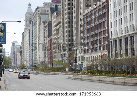 """CHICAGO - JUNE 14: Cars driving north on Michigan Avenue on June 14, 2011 in Chicago, Illinois. Michigan Avenue is also known as the """"Magnificent Mile."""" - stock photo"""