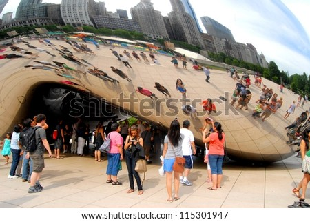 CHICAGO - JUNE 25: Chicago Cloud Gate Sculpture, The Bean at Millennium Park on June 25, 2011 in Chicago, Illinois USA. Sculpture made of steel, it was created by Anish Kapoor in 2004. - stock photo