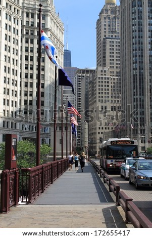 CHICAGO - JUNE 18: Crossing the Chicago River on Michigan Avenue.on June 18, 2012 in Chicago, Illinois. The Windy City is the third largest city in the U.S. and is a worldwide center of commerce. - stock photo