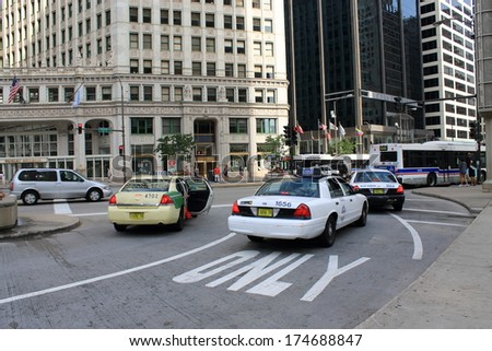 CHICAGO - JUNE 18: Taxi cabs on busy Michigan Avenue. on June 18, 2012 in Chicago, The Windy City is the third largest city in the U.S. and is a worldwide center of commerce.  - stock photo