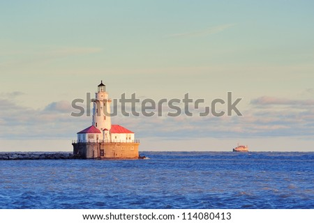 Chicago Light House in Lake Michigan with cloud and blue sky at sunset. - stock photo
