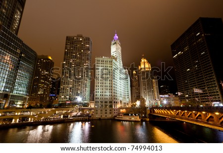 CHICAGO - NOVEMBER 14: The famous intersection of Michigan Ave and Chicago River on Nov. 14, 2010 in Chicago. Where many landmarks - Tribune Tower and Trump Tower the second tallest building in USA. - stock photo