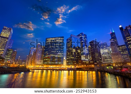 Chicago River and skyscrapers in financial district at dusk, IL, US - stock photo