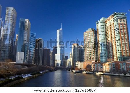 Chicago River with urban skyscrapers and riverwalk, IL, USA - stock photo