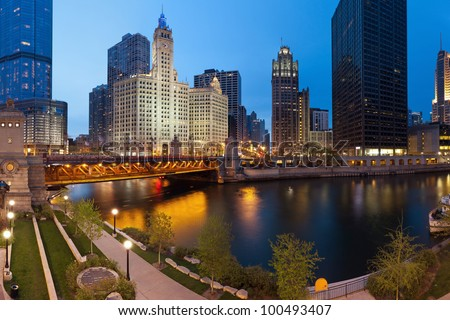 Chicago Riverside. Image of the Chicago riverside downtown district during sunset blue hour. - stock photo