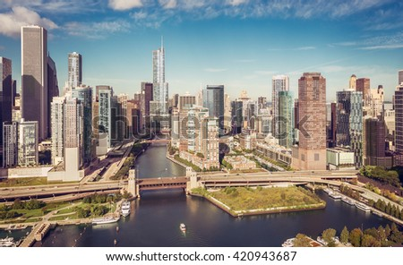 Chicago Skyline aerial view with boat on the river , vintage colors - stock photo