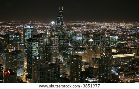 Chicago skyline at night- aerial view - stock photo
