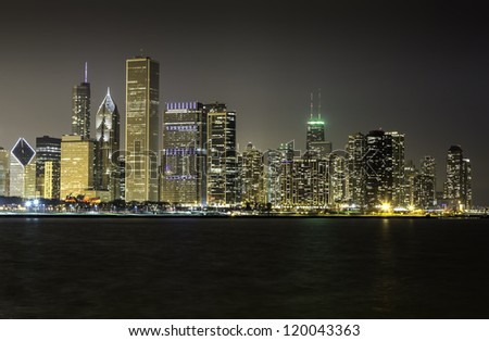 Chicago skyline at night illuminated by financial buildings - stock photo