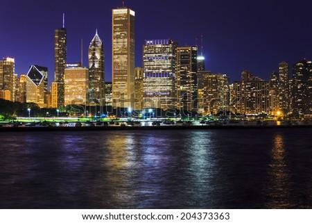 Chicago Skyline at Night over Lake Michigan - stock photo