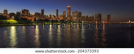 Chicago Skyline at Night over Lake Michigan - panorama - stock photo