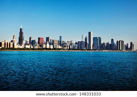 Chicago skyline over Lake Michigan early morning  - stock photo