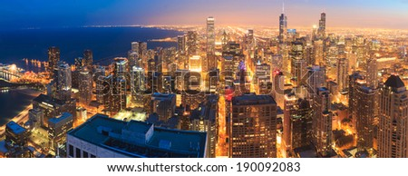 Chicago skyline panorama aerial view with skyscrapers over Lake Michigan with cloudy sky at dusk. - stock photo