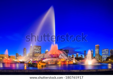 Chicago skyline panorama with skyscrapers and Buckingham fountain at twilight - stock photo