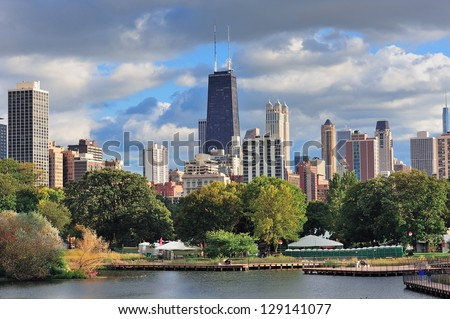 Chicago skyline with skyscrapers viewed from Lincoln Park over lake. - stock photo